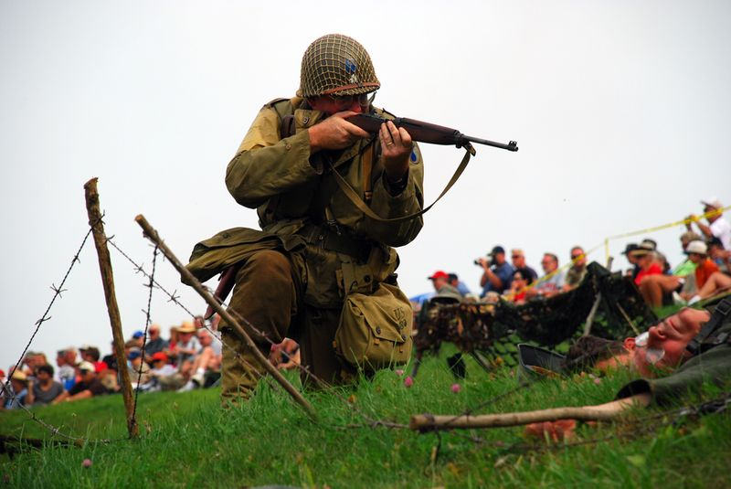 Pointing gun at german