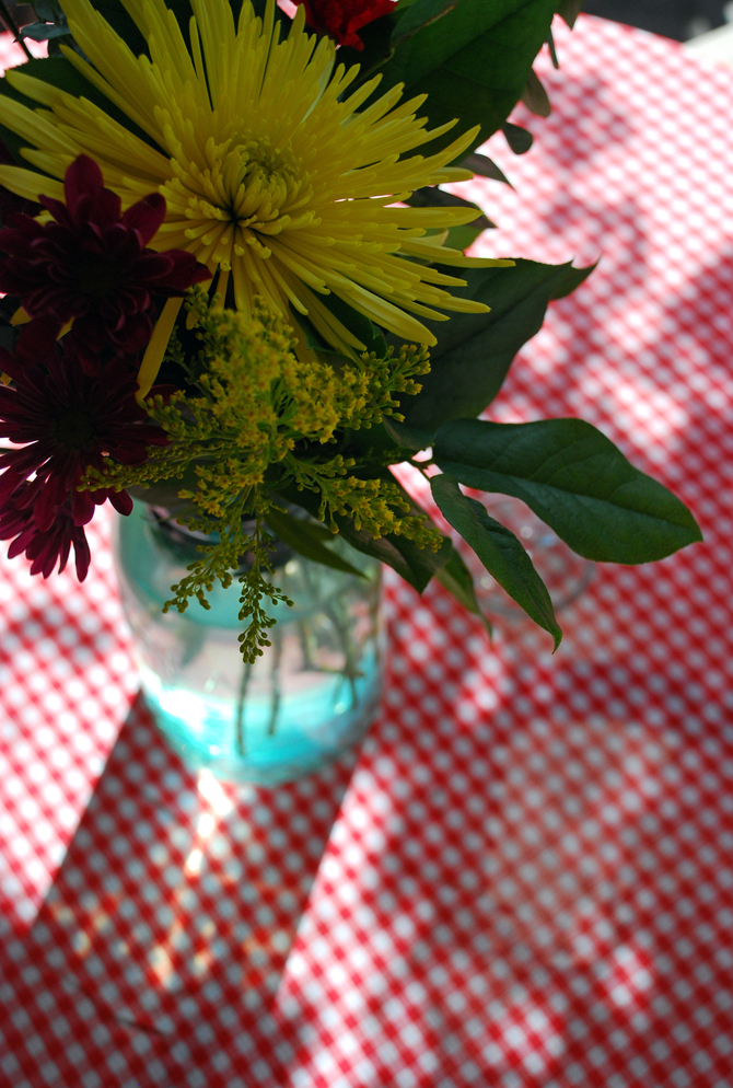 Flowers on checkered table cloth
