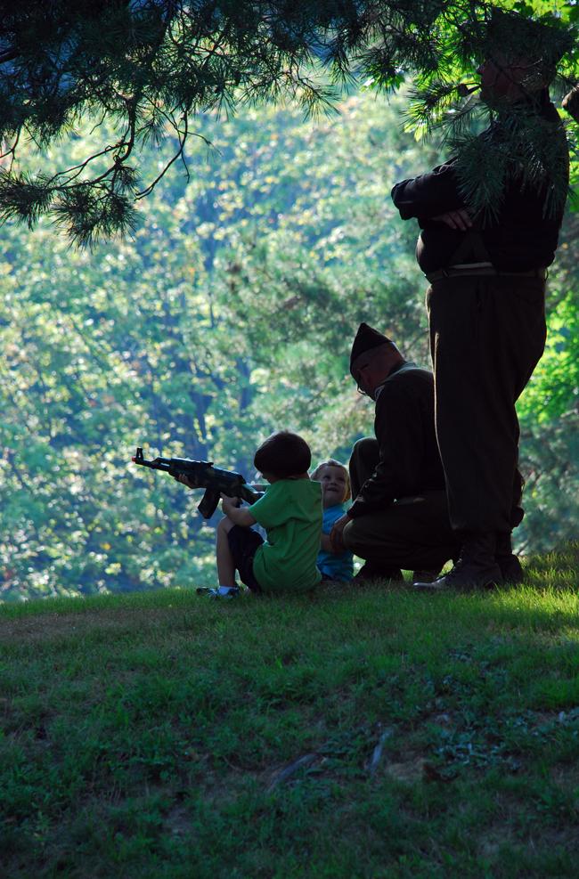 Little boy with gun